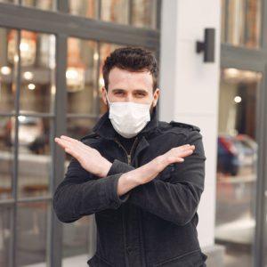 man-in-black-long-sleeve-shirt-wearing-white-face-mask-3983401